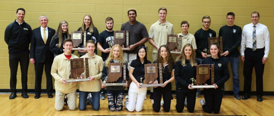 Penn is the only school in the state to win Sectional Championships in all eight IHSAA Fall Sports. Front row (from left), Chad Piatt, Curtis Cornell (BXC), Dani Spring (GXC), Lyvia Li, Abbey Hamilton (GGOLF), Kristina Lynch, Molly McLaughlin (GSOC); back row, Principal Sean Galiher, P-H-M Supt. Dr. Jerry Thacker, Rachel Hickey, Italia Fields (VB), Gabe Yeoman, Carrington Neal (FB), Eric Spaargaren, A.J. Antonelli (BTEN), Brandon Stahl, Micah Craig (BSOC), AD Aaron Leniski.