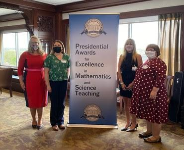 Ms. Amanda Fox (green shirt) with Indiana Secretary of Education Dr. Katie Jenner (red dress)