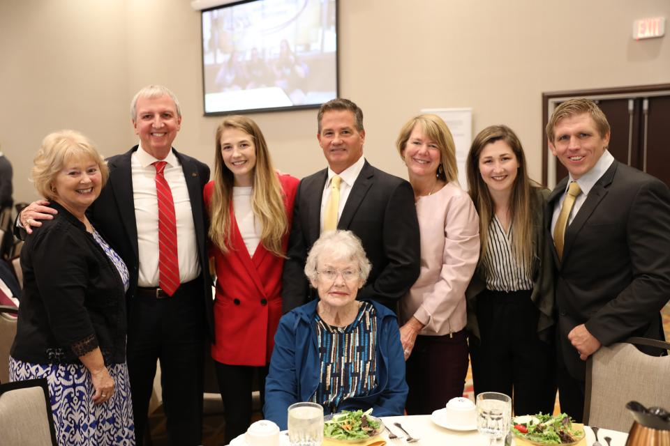 (left to right) Mrs. Donna Thacker, Dr. Jerry Thacker, Sarah Hildebrandt, Father: Chris, Mother: Nancy, Sister: Amy, Penn Wresting Coach Brad Harper, (sitting) Sarah's Grandmother