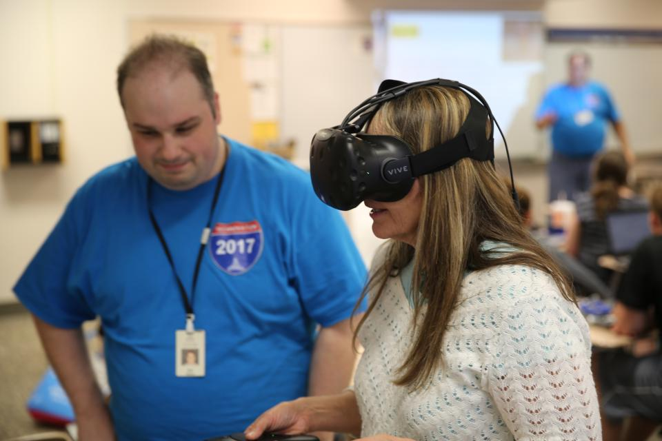 Grissom Asst. to the Principal Chris Grossnickle tries out  Interactive Virtual Reality