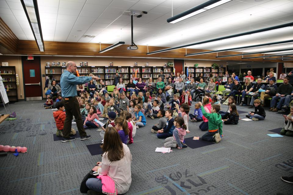 Children's author/illustrator Troy Cummings working with P-H-M students