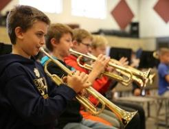 Discovery middle school students in band class