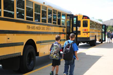Students loading Penn-Harris-Madison school buses
