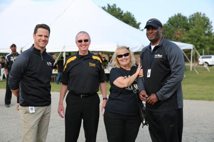 Principal Galiher, Dr. Thacker, Mrs. Thacker and Penn Asst. Principal Derrick White