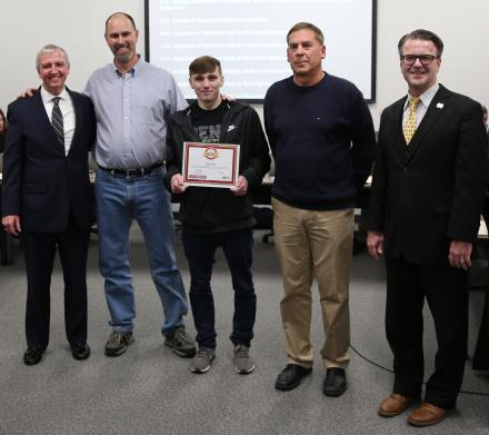 Penn-Harris-Madison Supt. Dr. Jerry Thacker, Paul Anderson, Heartsaver Hero Award recipient Logan Hill, Penn Health instructor Rod Pawlik, and P-H-M Board of School Trustees President Chris Riley.