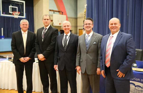Supt. Dr. Thacker & Board Pres. Chris Riley with Penn's new Athletic Director Jeff Hart, new P-H-M C.O.O. Aaron Leniski and Exec. Dir. of Business Svs. Jerry Hawkins.