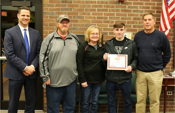 Principal Sean Galiher, Logan Hill and Rod Pawlik with the Logan Hill Family